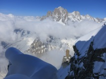 Looking over at the Aiguille verte with the top of the Aiguille de Republique in the sun in the foreground.