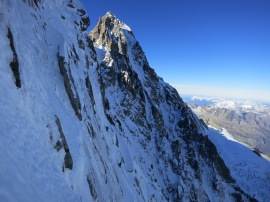 Looking over at the team on the Ginat. Aiguille verte in the sun.