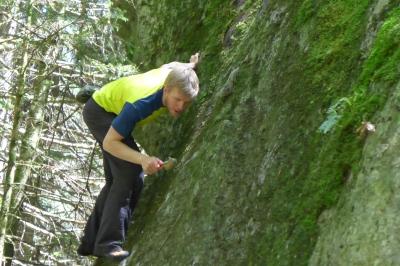 Ground up cleaning a V0 boulder problem.