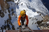 Tom Grant on the ladder to the Cosmiques arete platform.